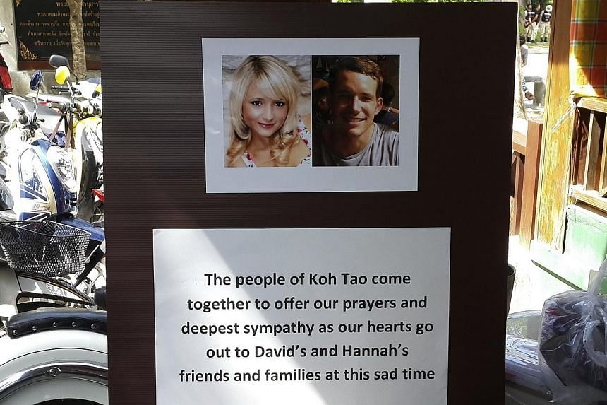 Pictures of killed British tourists David Miller and Hannah Witheridge and a message of support to their friends and families are displayed during special prayers at Koh Tao island on Sept 18, 2014. A Myanmar man has confessed to the murder of t