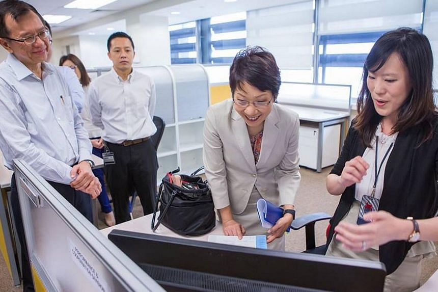 Minister in the Prime Minister's Office Grace Fu, who heads the MSO, visiting her team's new office on Thursday morning. -- GRACE FU'S FACEBOOK PAGE