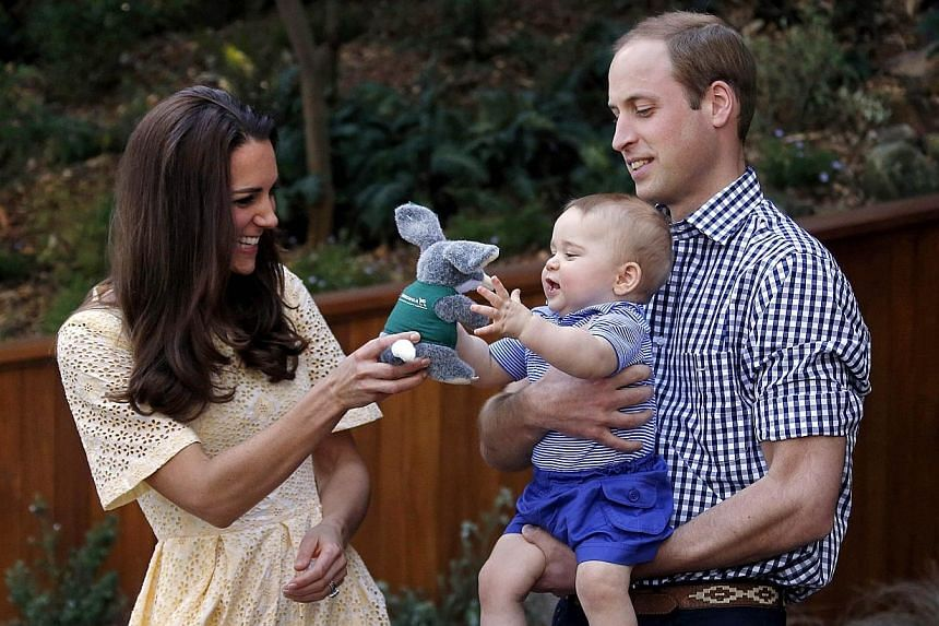 A file picture taken on April 20, 2014, shows Britain's Prince William, (right) his wife Catherine, the Duchess of Cambridge (left) and their son Prince George during a visit to Sydney's Taronga Zoo. -- PHOTO: REUTERS