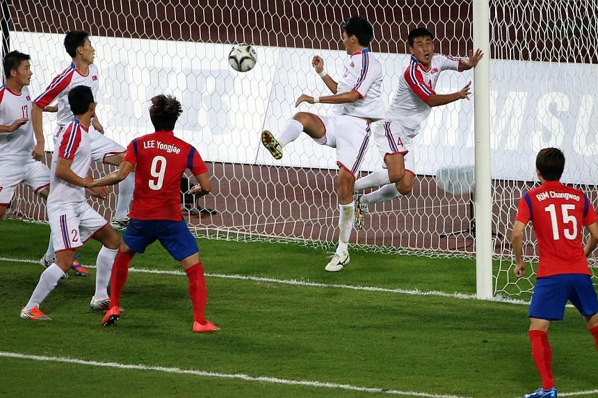 South Korea's Rim Chang Woo (#15) scoring the winning goal against North Korea in the Asian Game men's football finals, at the Munhak Stadium, in Incheon, South Korea, on Oct 2, 2014.-- ST PHOTO: NEO XIAOBIN