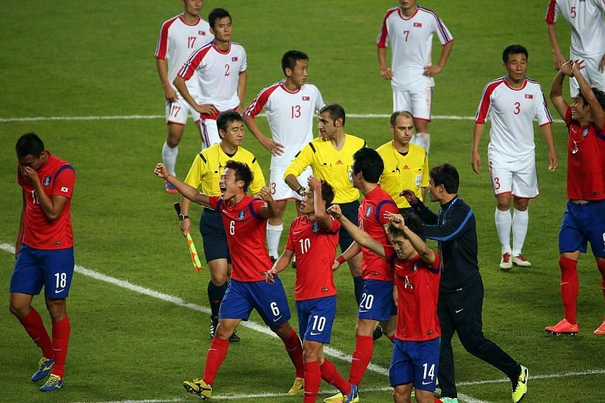 South Korea beats North Korea 1-0 in extra time to win the gold medal in the 17th Asian Games Incheon 2014 football men's final held at the Munhak Stadium, in Incheon, South Korea, on Oct 2, 2014.-- ST PHOTO: NEO XIAOBIN