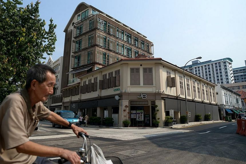 Carving out a space for a traditional neighbourhood fixture - the mama shop - earned points for the owners of J8 Hotel at this year's Urban Redevelopment Authority's (URA) Architectural Heritage Awards. -- ST PHOTO: JAMIE KOH