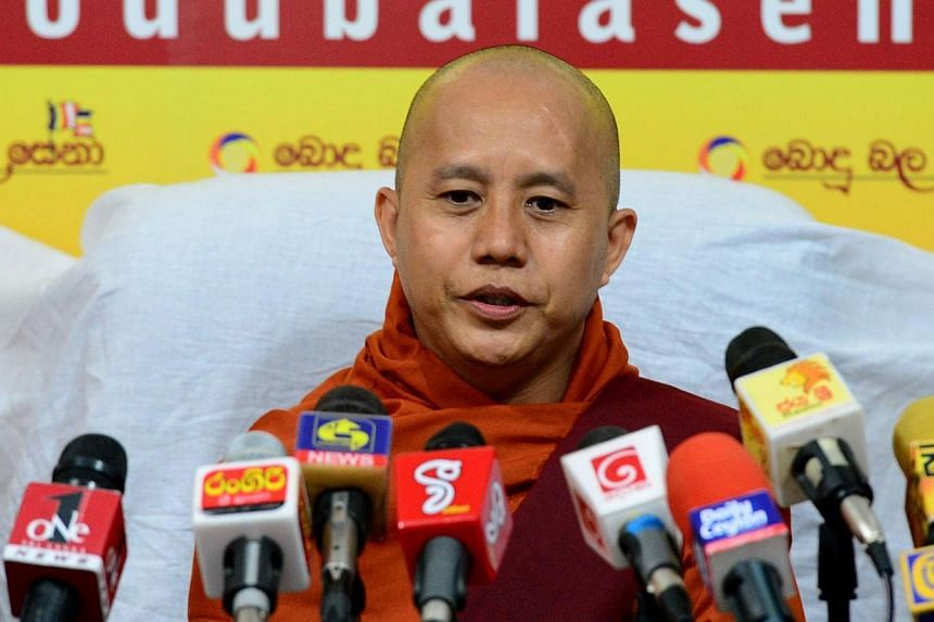 Myanmar Buddhist monk Ashin Wirathu addresses a press conference in Colombo on Sept 30, 2014. The Irrawaddy, a popular Myanmar news website, was blocked on Thursday by hackers accusingit of being pro-Muslim and slamming a blog it ran in Burmese