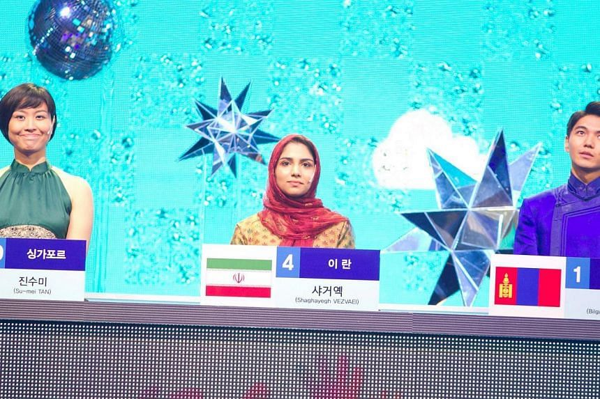 Singaporean April Tan (far left) beat the contestants from Iran and Mongolia in the finals of Quiz On Korea that was aired on KBS World and Ms Tan at a cultural event at the Singapore Korean International School. -- PHOTO: KOREA'S INTERNATIONAL EXC