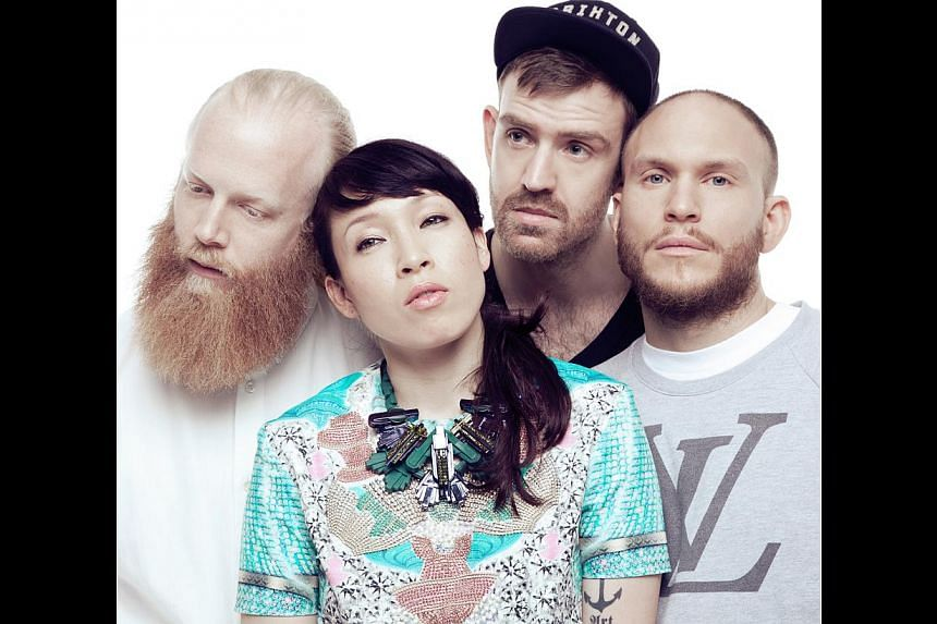 Singer Yukimi Nagano leads Little Dragon, comprising (from left) keyboardist Hakan Wirenstrand, bassist Fredrik Kallgren Wallin and drummer Erik Bodin. -- PHOTO: LANEWAY FESTIVAL SINGAPORE