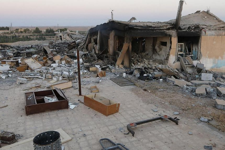 A general view shows a damaged school that was targeted on Monday by what activists said were US-led air strikes, at Ain al-Arous town in Raqqa governorate on Oct 1, 2014. -- PHOTO: REUTERS