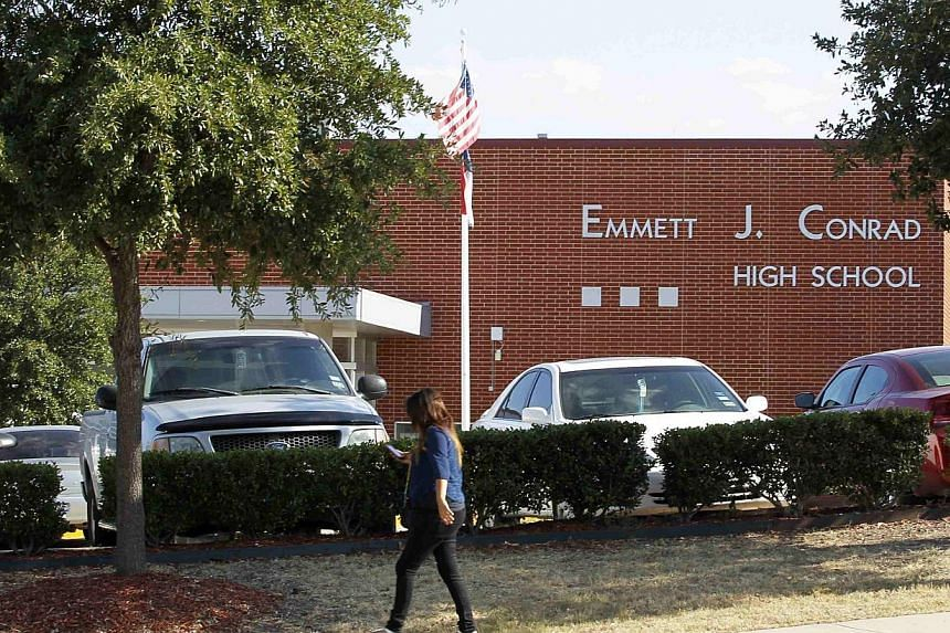 A student walks past Emmet J. Conrad High School in Dallas, Texas on Oct 1, 2014, where a fellow student came into contact with a man diagnosed with the Ebola virus.US health officials scoured the Dallas area on Wednesday for people - including