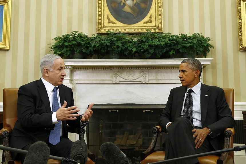 US President Barack Obama (right) meets with Israel's Prime Minister Benjamin Netanyahu at the White House in Washington on Oct 1, 2014. -- PHOTO: REUTERS