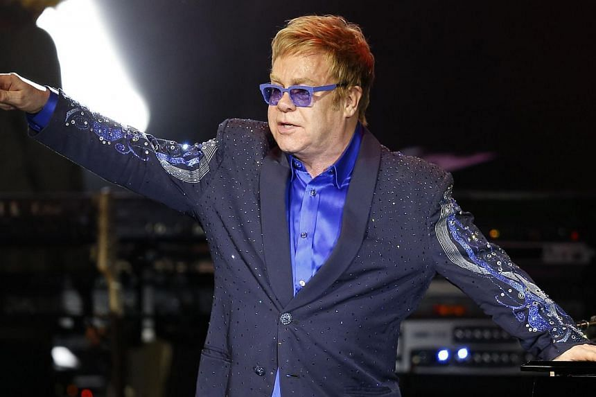British pop music icon Elton John (above) and his partner David Furnish will be the guests of honour when the Human Rights Campaign hosts its annual gala, the LGBT rights group said Wednesday. -- PHOTO: AFP