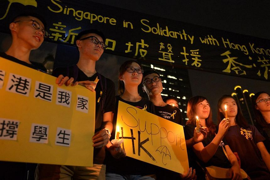 A group of supporters pose for a group photo during after a candlelight vigil at Hong Lim Park on Oct 1, 2014.-- ST PHOTO:CAROLINE CHIA