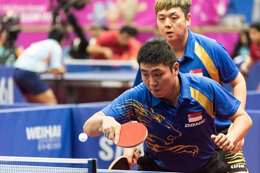 Singapore's Gao Ning and Li Hu (behind) in action at the Table Tennis Men's Doubles Round 2.SINGAPORE'S table tennis men's doubles pair of Gao Ning and Li Hu assured themselves of at least winning a medal at the Incheon Asian Games on Thursday.