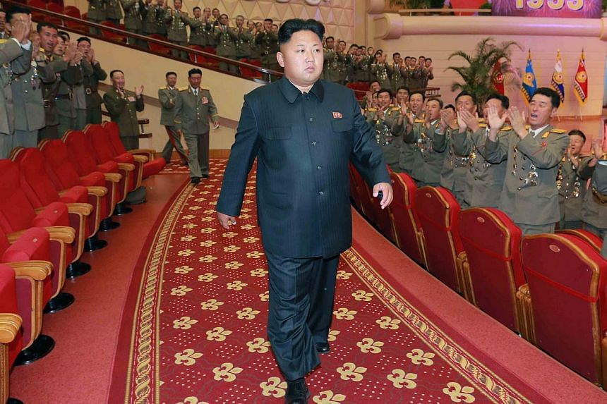 This undated file picture released by North Korea's official Korean Central News Agency (KCNA) on July 28, 2014, shows North Korean leader Kim Jong Un with Korean People's Army (KPA) service personnel, attending a performance given by the State Merit