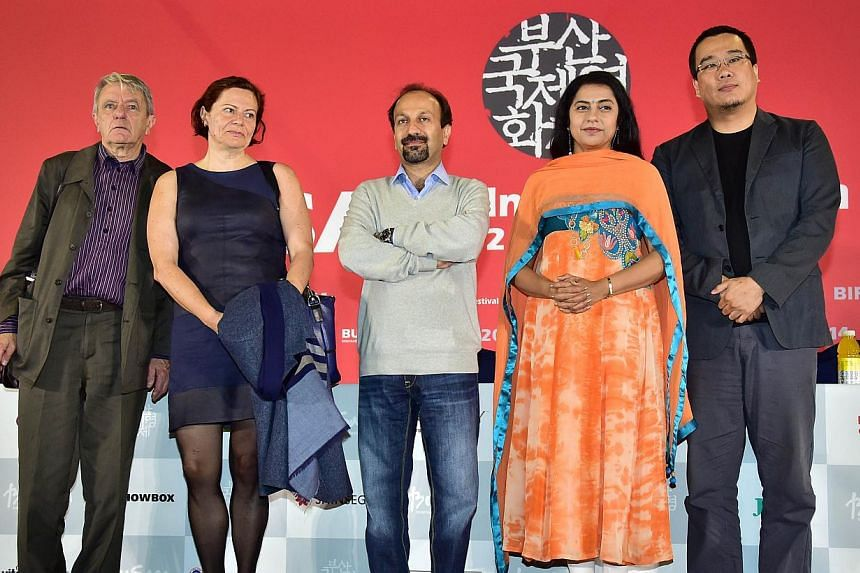 (Left-right) France's philosopher Jacques Ranciere, Britain's professor Dina Iordanova, Iran's director Asghar Farhadi, India's actress Suhasini Maniratnam and South Korea's director Bong Joon Ho pose after a press conference for the New Currents jur
