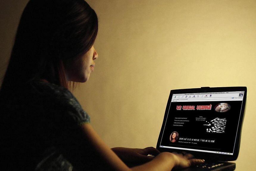 Over half of Singaporeans say they are not capable of lasting up to 12 hours without internet access. -- PHOTO: ST FILE