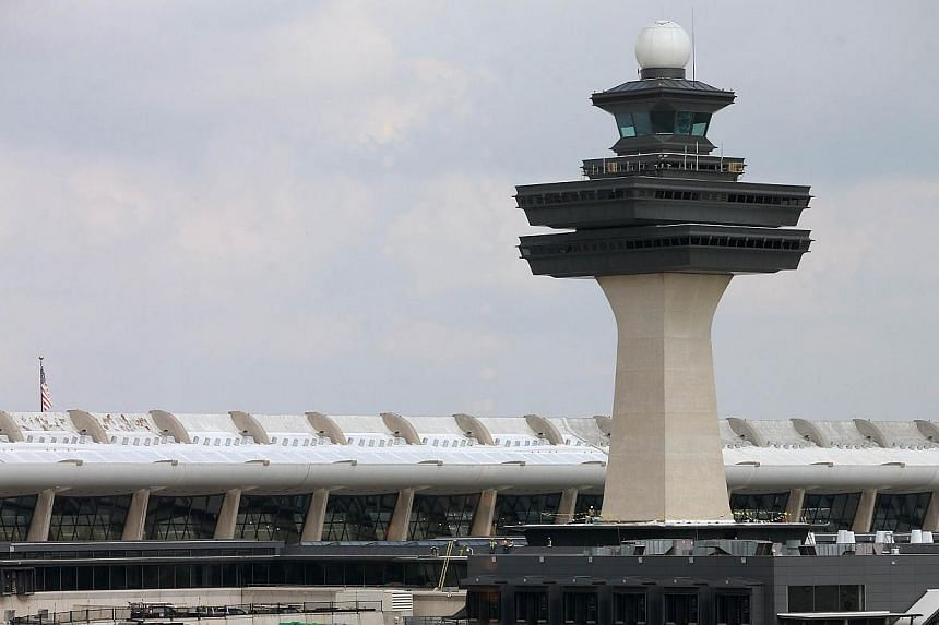 The main terminal at Washington Dulles International Airport on Oct 2, 2014, in Dulles, Virginia. The first person diagnosed in the United States for Ebola flew to Texas via Brussels and Washington. -- PHOTO: AFP