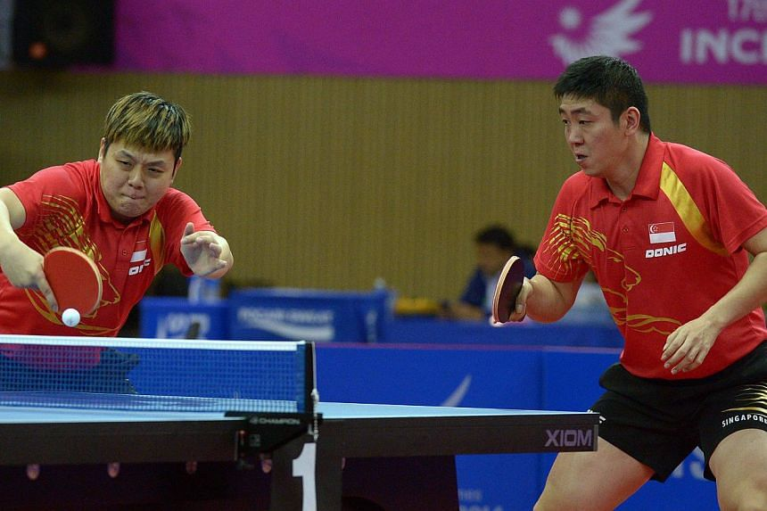 Singapore men's paddlers Gao Ning and Li Hu clinched the 12th bronze medal for Singapore at the Incheon Asian Games on Friday, despite losing their men's doubles semi-final match against China's Xu Xin and Fan Zhendong. -- ST PHOTO: DESMOND WEE