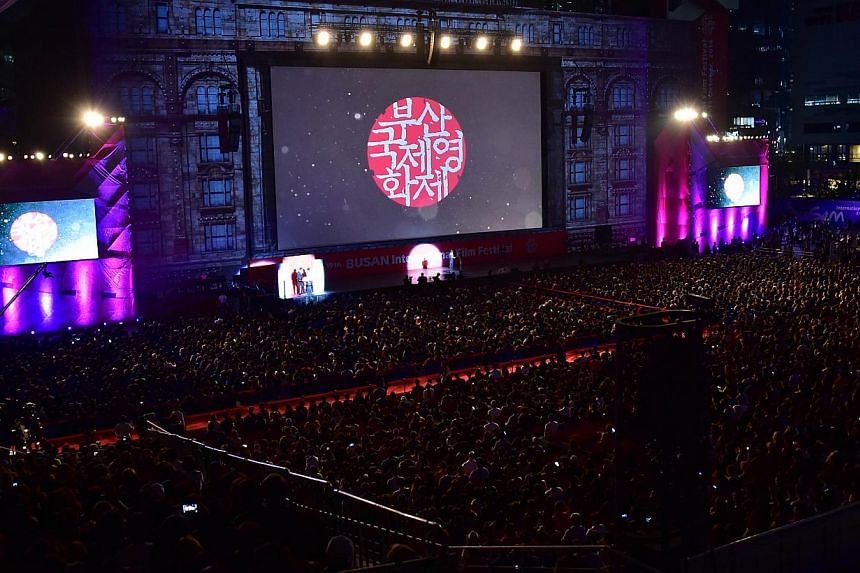 People attend the opening ceremony of the 19th Busan International Film Festival (BIFF) at the Busan Cinema Center in Busan on Oct 2, 2014. -- PHOTO: AFP