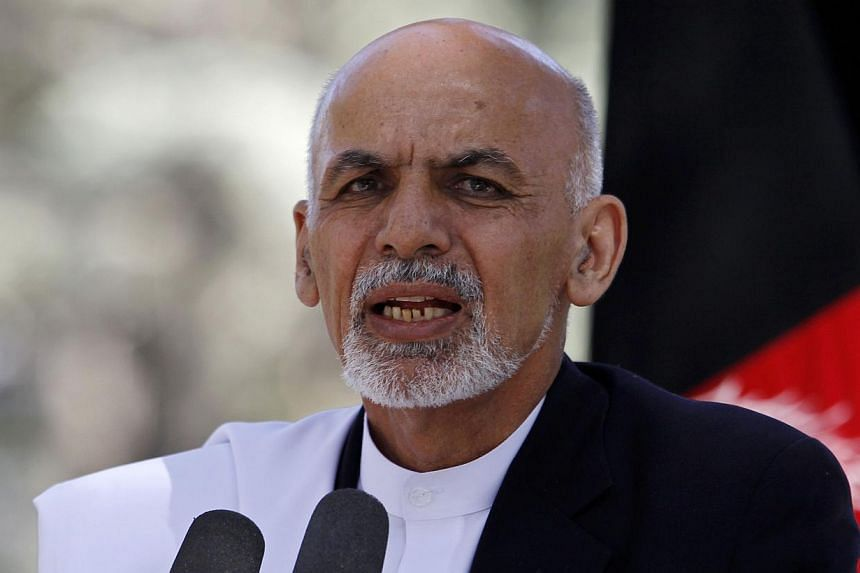 Newly-inaugurated Afghan President Ashraf Ghani on Friday, Oct 3, set a fresh tone in relations with Nato countries that have fought against Taleban insugents, paying a fulsome tribute to foreign soldiers who died in battle. -- PHOTO: REUTERS