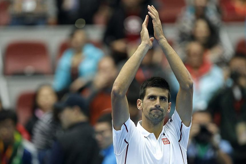 Novak Djokovic of Serbia celebrates winning against Grigor Dimitrov of Bulgaria during their men's quarter-final match at the China Open tennis tournament in Beijing on Oct 3, 2014.-- PHOTO: REUTERS