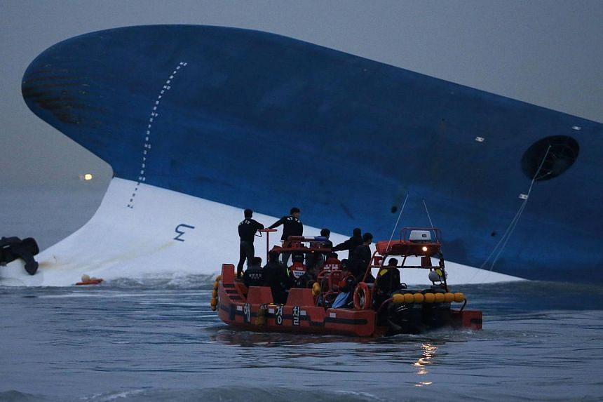 Maritime police search for missing passengers in front of the South Korean Sewol ferry which sank at sea, off Jindo, on April 16, 2014. Dozens of South Korean filmmakers and critics rallied behind a controversial film on the Sewol ferry disaster