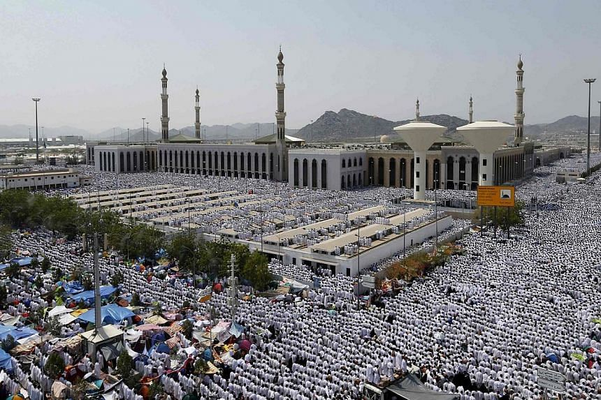 """Muslim pilgrims perform Friday prayers around Nimrah mosque on the plains of Arafat during the annual haj pilgrimage, outside the holy city of Mecca on Oct 3, 2014.The enemies of Muslim nations are trying to spread """"chaos and confusion"""", Saudi"""