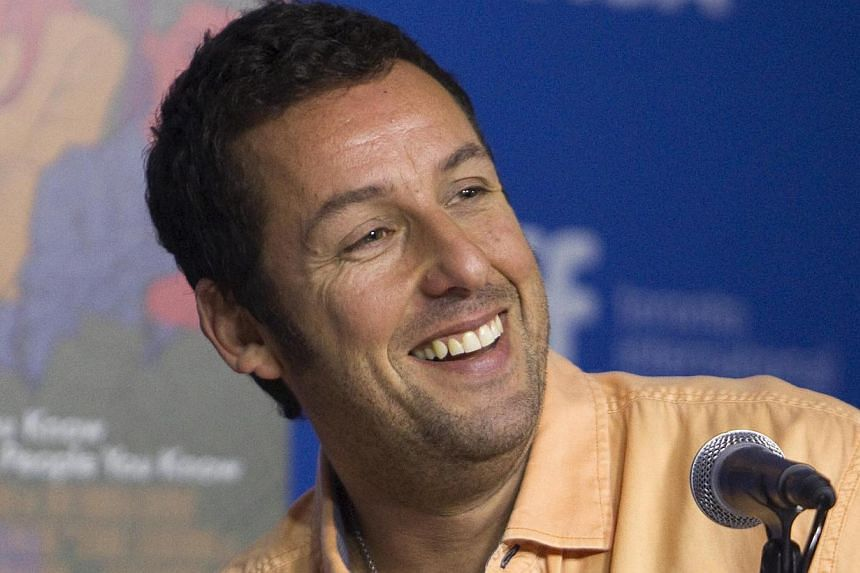 Netflix announced on Thursday it has signed comic actor Adam Sandler to produce four films for the streaming video group, expanding its foray into cinema. -- PHOTO: REUTERS