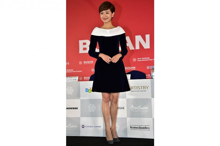 Chinese actressRegina Wan poses after a press conference on the opening film Paradise In Service of the Busan International Film Festival (BIFF) at the Busan Cinema Center in Busan on Oct 2, 2014. -- PHOTO: AFP