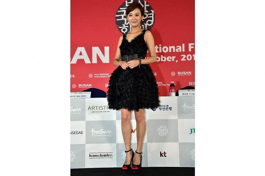 Taiwanese actressIvy Chen poses after a press conference on the opening film Paradise In Service of the Busan International Film Festival (BIFF) at the Busan Cinema Center in Busan on Oct 2, 2014. -- PHOTO: AFP