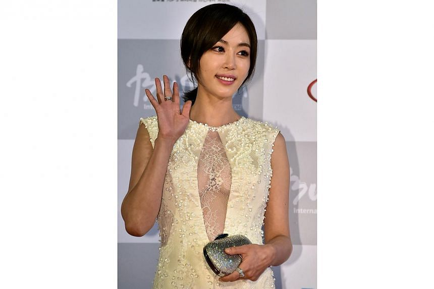 South Korean actress Kang Ye Won walks on the red carpet for the opening ceremony of the 19th Busan International Film Festival (BIFF) at the Busan Cinema Center in Busan on Oct 2, 2014. -- PHOTO: AFP