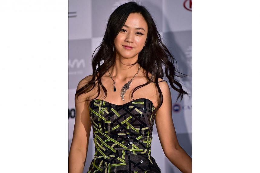 Chinese actress Tang Wei walks on the red carpet for the opening ceremony of the 19th Busan International Film Festival (BIFF) at the Busan Cinema Center in Busan on Oct 2, 2014. -- PHOTO: AFP