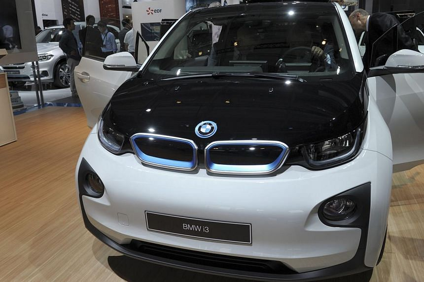 The BMW i3 is unveiled at the Paris Auto Show on Oct 2, 2014, on the first of the two press days. -- PHOTO: AFP
