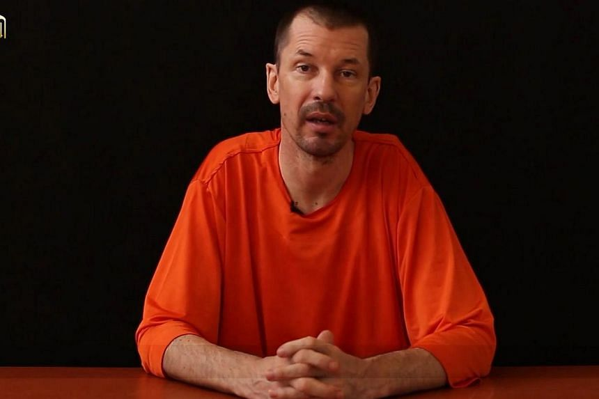 The father of captive British journalist John Cantlie issued a statement on Friday pleading for his son's release and said his family had tried to communicate with the Islamic State (IS) insurgent group holding him. -- PHOTO: AFP