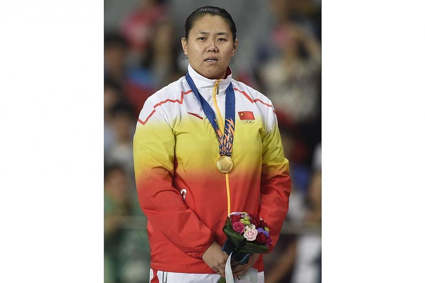Women's hammer gold medallist Zhang Wenxiu of China has failed a doping test at the Asian Games and has been thrown out of the competition, the Olympic Council of Asia (OCA) announced on Friday. -- PHOTO: AFP