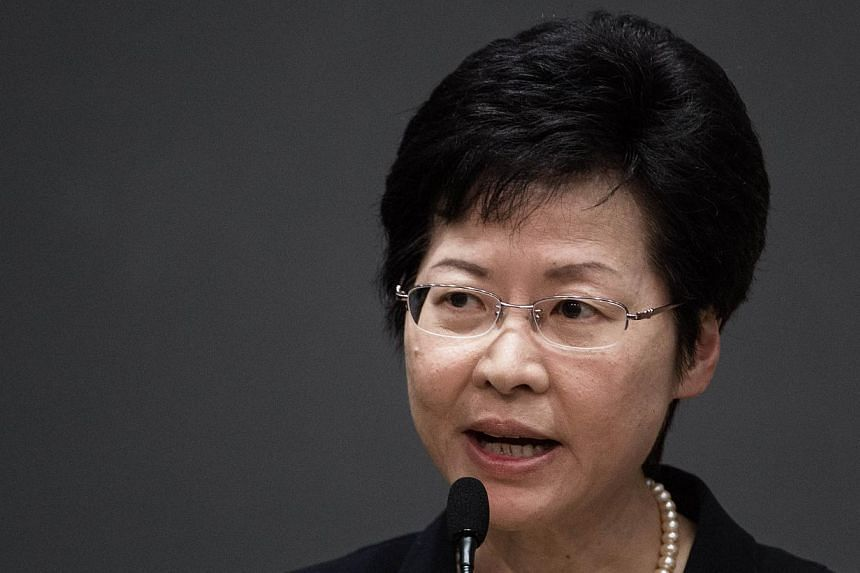 Hong Kong's Chief Secretary Carrie Lam addresses a press conference in Hong Kong on July 15, 2014. -- PHOTO: AFP