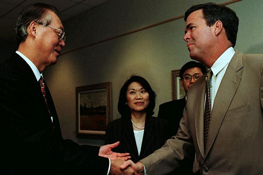 A 2005 file photo shows then Singapore prime minister Goh Chok Tong meeting Mr Jeb Bush, who was Florida's governor at the time, in San Jose, California. Former US president George W. Bush said on Thursday that his younger sibling Jeb wants the White