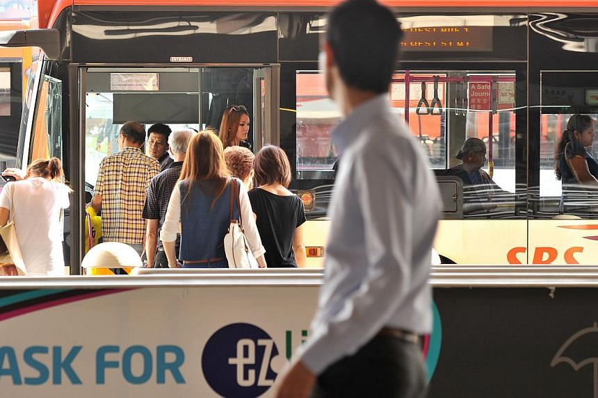 Commuters boarding a bus at Jurong East bus interchange. The Land Transport Authority (LTA) has put up the first package of bus routes for tender. -- ST PHOTO: LIM YAOHUI