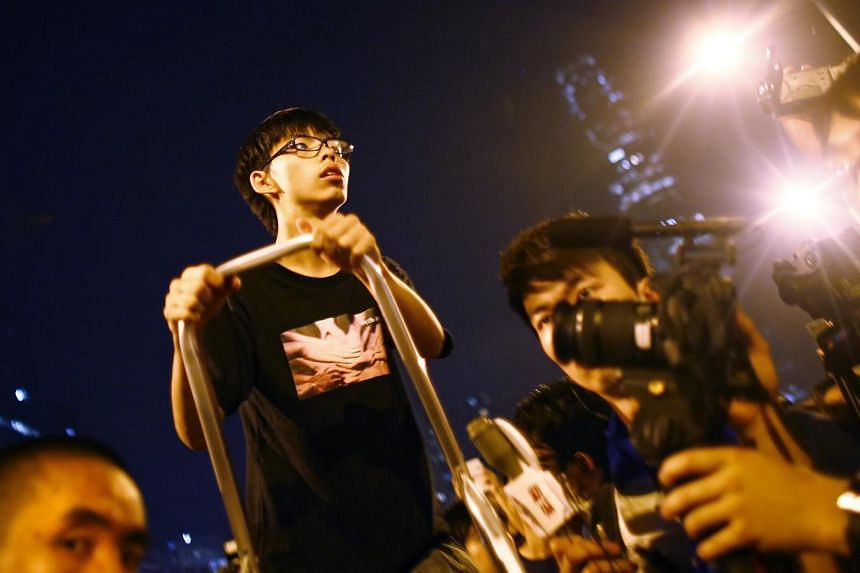 Leader of the student movement Joshua Wong takes a break after delivering a speech to protesters outside the offices of Hong Kong Chief Executive Leung Chun-ying in Hong Kong on Oct 3, 2014.Student leaders whose pro-democracy protests have grip