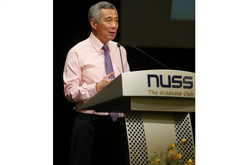It is the responsibility of Hong Kong and Beijing to make one country, two systems work, and if other parties get involved, it will not be helpful, said Prime Minister Lee Hsien Loong on Friday night.-- ST PHOTO:CHEW SENG KIM
