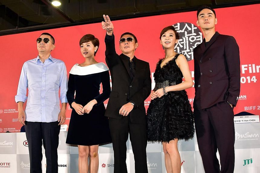(Left-right) Taiwanese actor Chen Jianbin, Chinese actress Regina Wan, Taiwanese director Niu Doze, Taiwanese actress Ivy Chen and Taiwanese actor Ethan Juan pose after a press conference of the opening film Paradise In Service of the Busan Inte