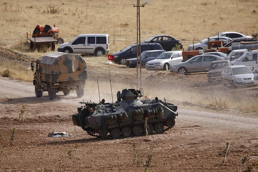 A Turkish military armoured vehicle takes position on the Turkish-Syrian border near the south-eastern Turkish town of Suruc in Sanliurfa province on Oct 3, 2014. Damascus has said that any Turkish military intervention on Syrian soil would be consid