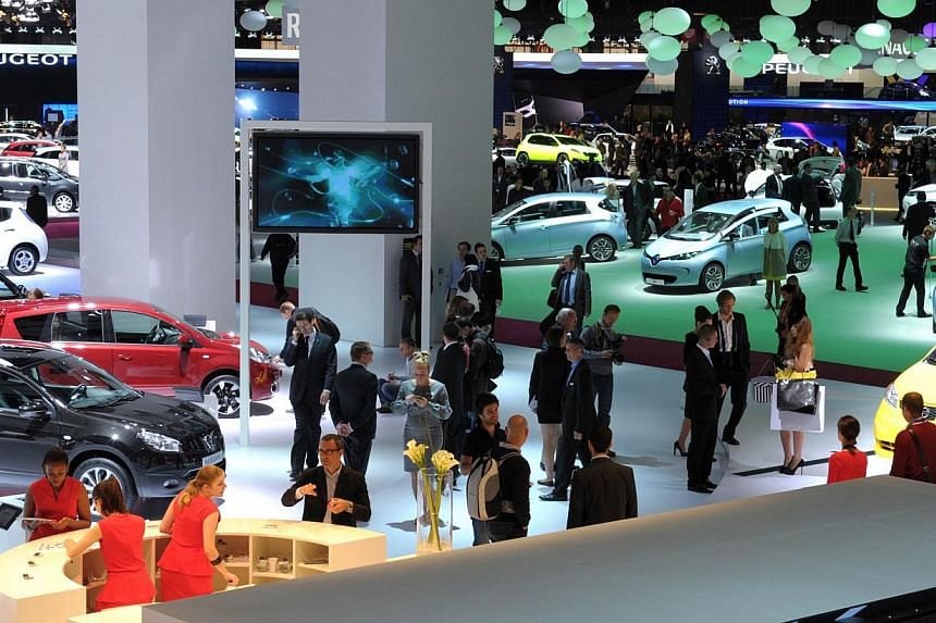 A file photo shows visitors walking between stands during the press days at the Paris Motor Show. The 2014 show runs from Oct 4, to Oct 19, 2014. PHOTO: AFP