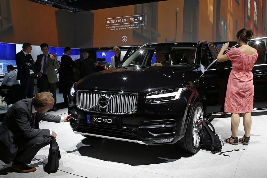 People look at a Volvo XC90 displayed on media day at the Paris Mondial de l'Automobile Oct 2, 2014. The Paris auto show opens its doors to the public from October 4 to October 19. -- PHOTO: REUTERS