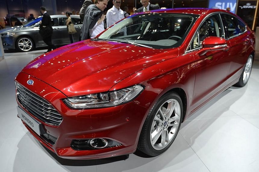 The new Ford Mondeo is presented at the Paris Auto Show in Paris on Oct 2, 2014. -- PHOTO: AFP