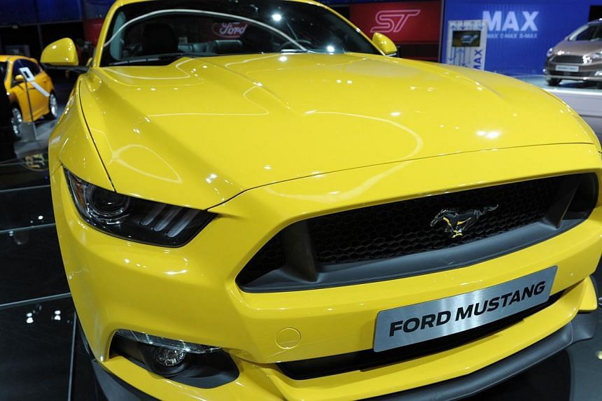 A Ford Mustang 2015 is displayed at the 2014 Paris Auto Show on Oct 2, 2014, in Paris. -- PHOTO: AFP