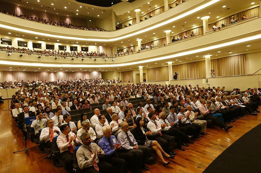 The crowd at the University Cultural Centre listening to PM Lee giving his speech.--ST PHOTO: CHEW SENG KIM