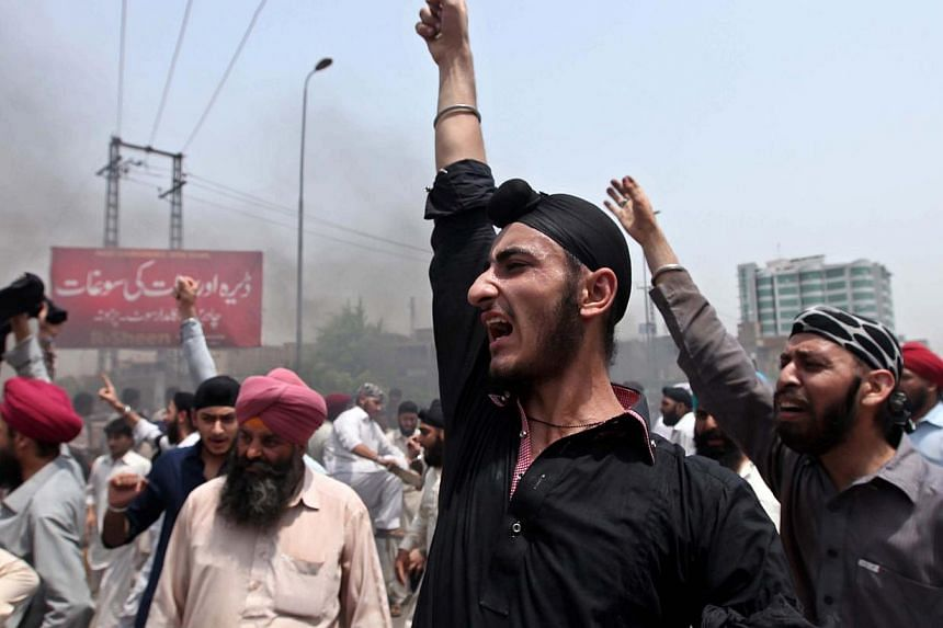 Pakistani minority Sikhs protest against the killing of a colleague on a street in Peshawar on Aug 6, 2014. Members of Pakistan's Sikh community say they have been singled out and attacked increasingly in the South Asian nation where radical Islamist