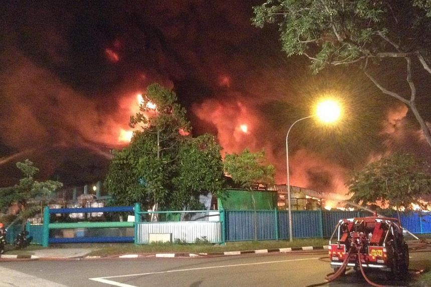 About 60 firefighters put out an early morning fire at a plastic materials factory on Friday. -- PHOTO: STOMP