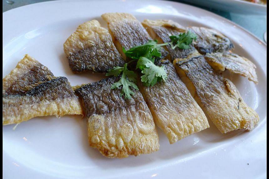 Pan fried yellow croaker fish from Chui Huay Lim Teochew Cuisine. -- ST PHOTO: WONG AH YOKE