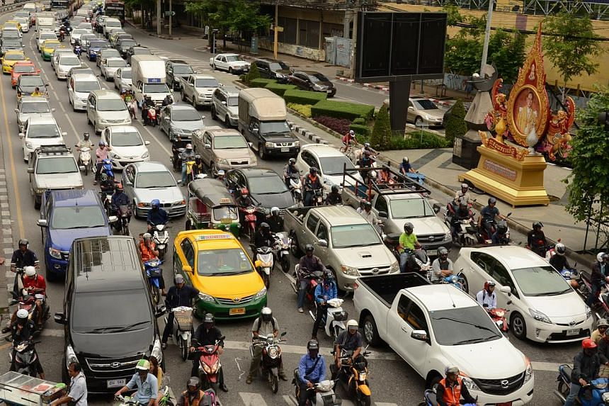 Traffic on Ratchadaphisek Road, a major thoroughfare in Bangkok, Thailand, in a 2013 file photo.Thailand's auto lenders have repossessed three times as many cars as they did a year ago as defaults soar in a flatlining economy. -- ST FILE PHOTO