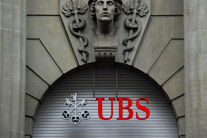 A logo of the Swiss banking giant UBS seen above its headquarters in downtown Zurich on Oct 15, 2011. -- PHOTO: AFP